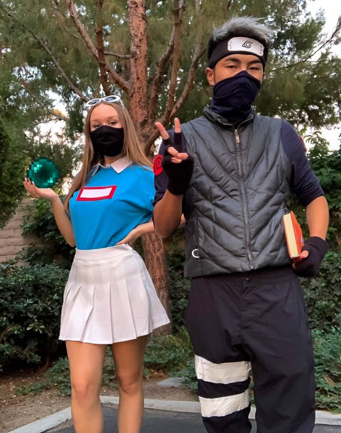 Junior+Kate+Brooks+and+senior+Isaac+Yang+dressed+up+in+creative+costumes+that+also+incorporated+their+masks+to+ensure+they+were+both+following+CDC+health+guidelines.