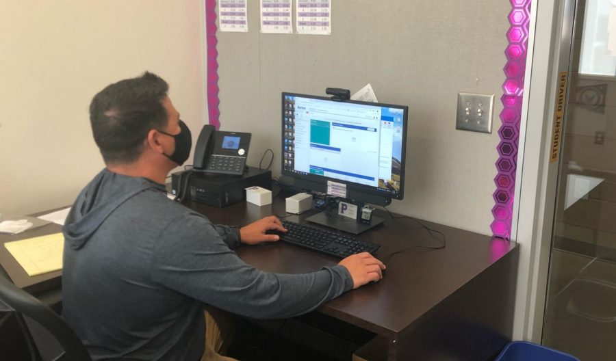 Project Success specialist Gil Carey organizes his schedule of student meetings after school. Carey constantly sorts through new appointments and emails in order to make room for several sessions with students throughout the day during breaks, lunches and before school.