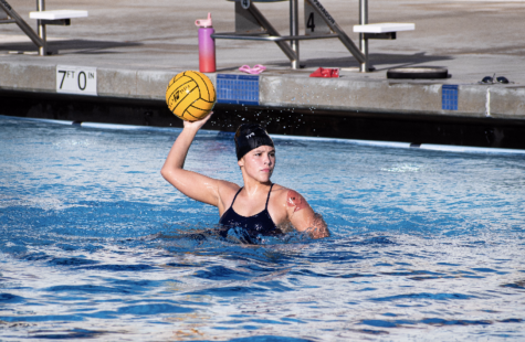 Although coaches have been doing everything in their power to conduct fair tryouts considering COVID-19 restrictions, athletes and coaches alike look forward to a day when players will truly be able to play together, both mentally and physically. Freshman Andi Ruiz is shown shooting a ball during tryouts.