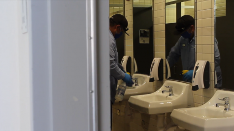 Physical education equipment custodian Noe Belmudez cleans the sinks in one of the restrooms during second period with a special disinfectant. During each period, the custodial staff must clean every restroom on campus, as well as any other area classified as a high touch point.