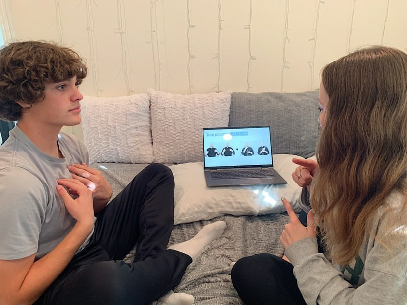 "Club member and freshman Alexander Epps often practices signing to  co-president and junior Julianna Epps in one-to-one conversations. Together, they work on basics by asking and answering questions in sign language like, ""Do you have a sister?"""