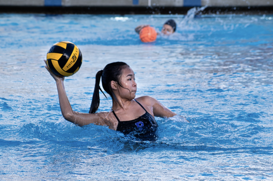Junior Camryn Chung aims for a shoot in an endurance drill during water polo practice. Players are not yet allowed to pass balls to one another due to COVID-19 precautions but are permitted to pass to coaches.