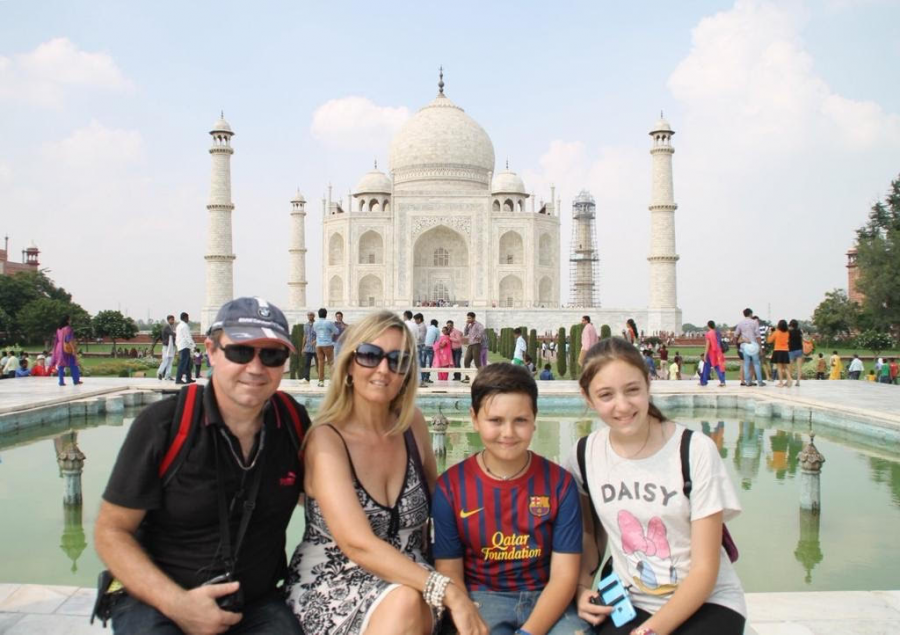 """Senior Gina Cardini, along with her parents and younger brother, visit the Taj Mahal on one of the many excursions the family took during their time living in India. """"I cherish those six years of my life with all my heart,"""" Cardini said. """"Everything that Ive done in those six years are literally some of my favorite memories in the world."""""""
