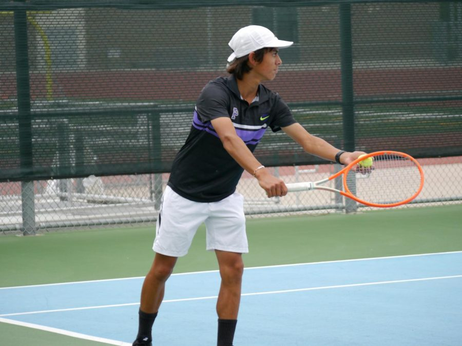 Junior AJ Moore enters form before hitting a forehand in a serve. The Bulldog's number one singles players, Moore beat Sage Hill High's number one singles player 6-2, according to head boys' tennis coach Natasha Schottland.