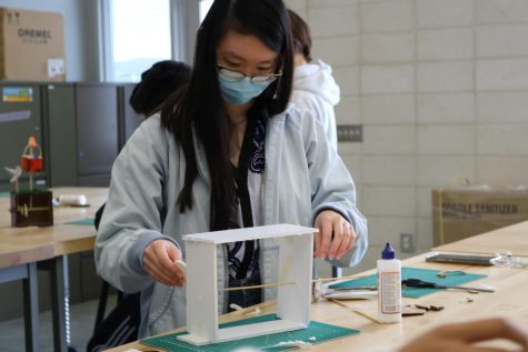 Senior Natalie Yu constructs a prototype of a small mechanical 'automata box' during Introduction to Engineering Design, which was first introduced as a course option for the 2020-21 school year. The debut of Principles of Engineering next school year is the second step of a collaborative effort between engineering teacher Anthony Pham, principal John Pehrson and IUSD's ROP/CTE division to create an engineering pathway for Portola High students.