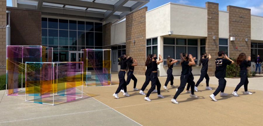 Cohort A of Dance Company performs a hip-hop number to
