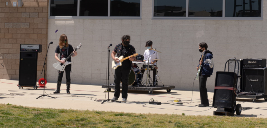 Music teacher Kyle Traska's eighth-period Contemporary/Pop Performance Ensemble class shows off their vocal skills and instrumental technique by playing a set of rock anthems on April 9. The group includes senior and guitarist Trevor Howden, senior and bassist Jeffery Mejia, sophomore and drummer Sky Jaan and junior and guitarist Cody Maier.