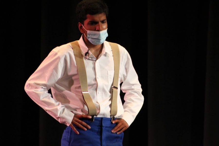 """Senior Samir Behera performs as Mr. Forbes in the play """"The Wreck on the 5:25,"""" the last play of his high school theater career."""