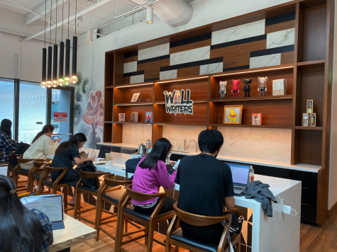 During its hours of operation, Wall Writers Coffee is often filled to the brim with individuals studying or working. The large, white, modern tables make collaboration easy.