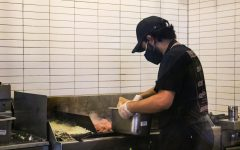 Alumnus and UCSD freshman Farhad Taraporevala lays down meat on the grill, one of the most important roles to ensure that each bowl or burrito has the authentic Chipotle taste. As the most experienced worker of the trio, Taraporevala introduced his former bandmates to work at the Woodbury Town Center Chipotle.