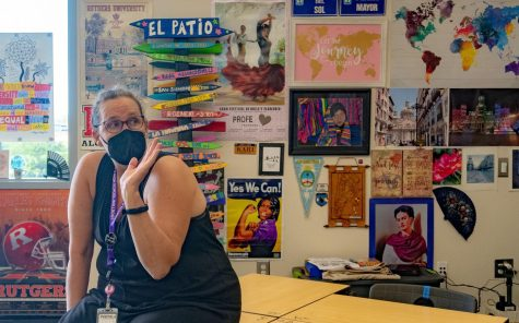 """Upon entering Spanish teacher Kari Tubbs' classroom, it is impossible to ignore the bright assortment of posters, photographs and artwork that cover nearly every inch of her walls.  """"Students tell me that they like it; they like that they come in and it's colorful, they like that they come in and see different things, and there's stuff to look at,"""" Tubbs said. """"They get to know me through what I put up. That's why I'll just keep doing it."""""""