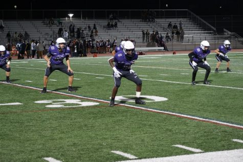 The Bulldogs perform their end-of-game ritual, celebrating Portola's 6-0 win streak as victorious cheers erupt from the students.