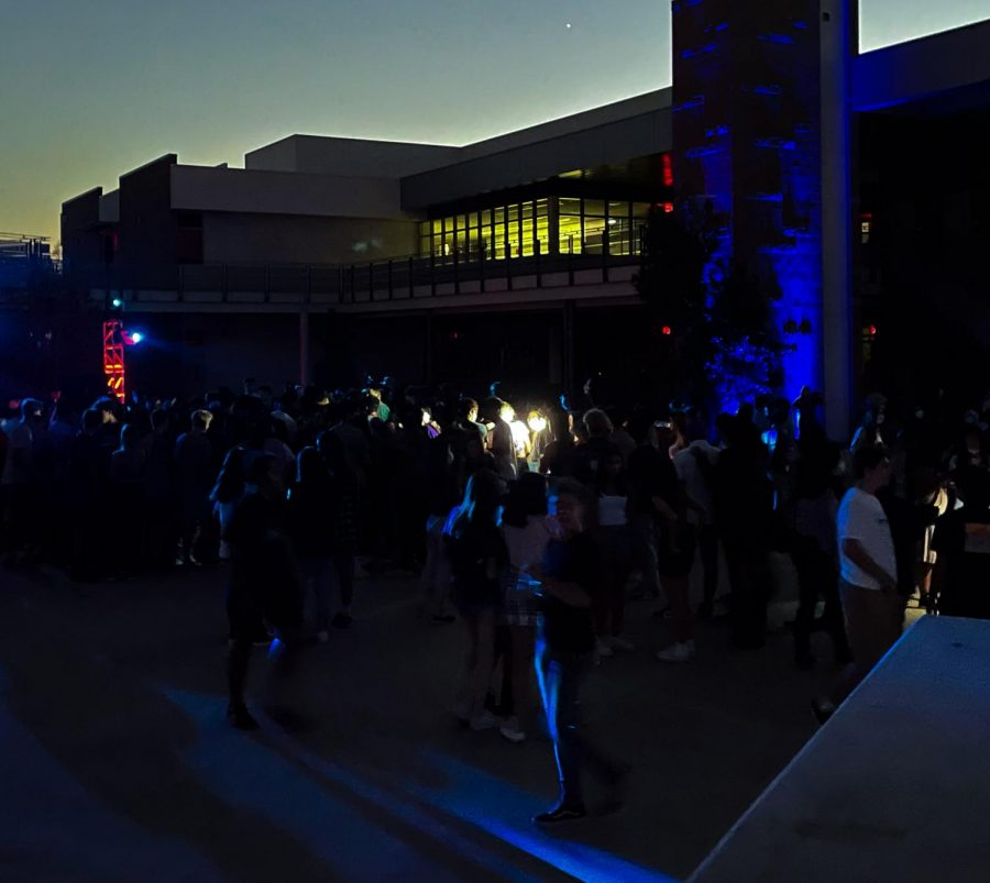 """Students gathered in the mosh pit and formed a circle while jumping to the music, """"Baby"""" by Justin Bieber. Most ASB members were found in the center of the pit holding flashlights, surrounded by the three other graduating classes."""