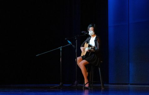 """Senior Kristen Fong sings and plays the guitar to """"Vienna"""" by American singer and songwriter Billy Joel. """"I was less nervous than I thought I was going to be, but then I got on stage, and then I was like, 'Okay, keep going, alright,' and then I immediately forgot the lyrics in the middle of the song,"""" Fong said. """"But I think my recovery was alright."""""""