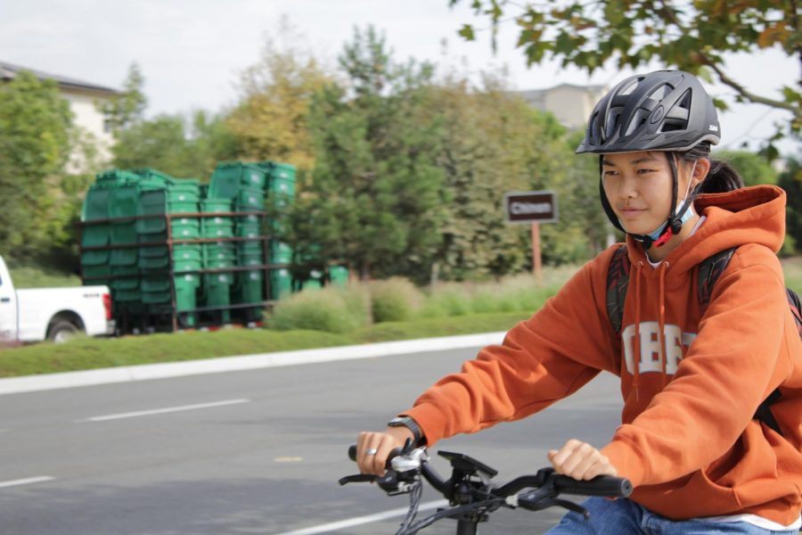 Sophomore+Kaylin+Wong+rides+her+electric+bike+home+from+school+along+Irvine+Blvd.+on+Oct.+6.+The+roadway+abuts+the+Eastern+Transportation+Corridor+Toll+Road+%E2%80%93+the+crossing+where+freshman+Shifa+Harsolia+was+hit+while+cycling+home+from+school+on+Sept.+10.