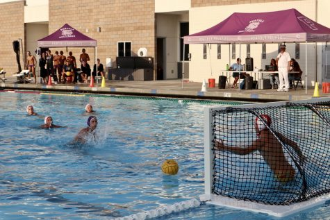 Sophomore Noam Garibi shoots the penalty shot on the goal from the 5- meter line during the second quarter. He scored four points in total throughout the game.